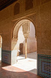 Details of the inner courtyard, Alhambra. Granada. Very detailed sculptures on the walls stock images