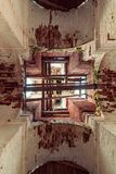 Details of the interior of the destroyed Orthodox Church of St. Nicholas in the forests of the Kostroma region. Details of the interior of the bell tower of the Stock Photography