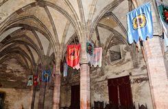Details from the interior room of the Corvins Castle build by John Hunyadi, logo flags. royalty free stock photography