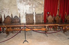 Details from the interior room of the Corvins Castle build by John Hunyadi, royal chairs. royalty free stock photo