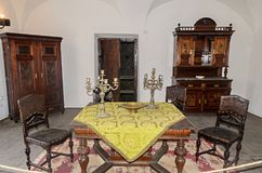 Details from the interior room of the Corvins Castle, old table and closet. royalty free stock photography