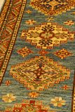 Details of intricate blue patterns in Turkish carpets Royalty Free Stock Photography