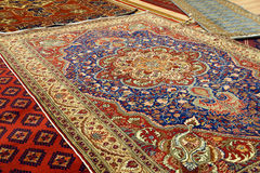 Details of intricate blue patterns in Turkish carpets Stock Photo