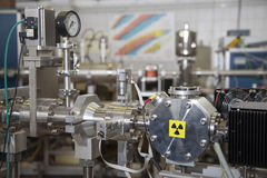 Details of ION accelerator with radiation warning sign Royalty Free Stock Photography