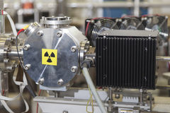 Details of ION accelerator with radiation warning sign Stock Images