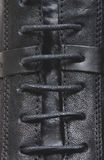 Details of the lacing on black leather Royalty Free Stock Photo