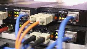 Details from loaded and working network switch with fiber media converter stock video footage