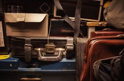 Old Dusty Suitcases. Details of a lot of old and dusty suitcases and boxes Royalty Free Stock Photo