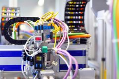 details of a machine with pneumatic lines in industrial production for electronic components stock photography