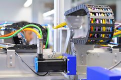 details of a machine with pneumatic lines in industrial production for electronic components stock photo
