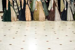 Details with the medieval/Renaissance dresses of women singing in a choir