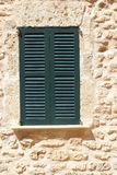 Mediterranean architecture with green shutters Royalty Free Stock Images