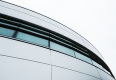 Abstract view of a modern, IT related headquarters showing its artistic presence. Details of the metal clade design, symmetry and curves are apparent in this Stock Photos