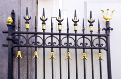 Details of metal gold decorated gate fragment. Stock Photography