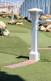 Details in Miniature Golf Course. Fake plastic grass on a miniature golf course on a luxury cruise ship Stock Image