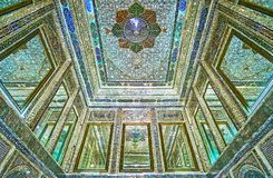 Details of mirror hall in Qavam House, Shiraz, Iran. SHIRAZ, IRAN - OCTOBER 12, 2017: The rich decors of mirror hall of Qavam Ghavam House in Naranjestan complex Stock Images