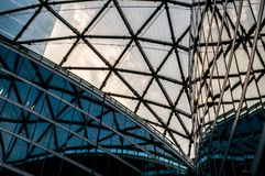 Details of modern architecture, glass office buildings. The ceiling of a futuristic businness center stock image