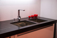 Details of modern kitchen sink with tap faucet. Details of modern design trendy  kitchen sink with water tap faucet Stock Photography