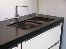 Details of modern kitchen sink with tap faucet. Details of modern design trendy  kitchen sink with water tap faucet Royalty Free Stock Images