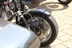 Details of a motorcycle with a stroller.  royalty free stock photography