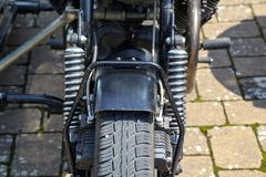 Details of a motorcycle with a stroller.  royalty free stock images