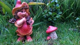 Details. Mushroom doll in the garden Stock Image