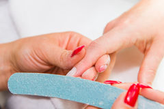 Details of nail polishing Stock Images