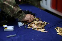 Details with 5.56 NATO ammunition on a table on a shooting range.  stock images