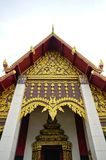 Details of northern style Thai temple roof on cloudy sky Royalty Free Stock Images