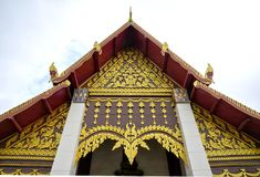 Details of northern style Thai temple roof on cloudy sky Royalty Free Stock Photography