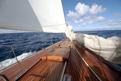 Details Of A Classic Wood Sailboat In Open Waters. Stock Images