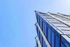 Free Details Of Office Building Exterior. Business Buildings Skyline Looking Up With Blue Sky. Modern Architecture Apartment. High Tech Stock Image - 115499581