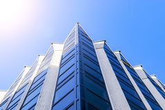 Details of office building exterior. Business buildings skyline looking up with blue sky. Modern architecture apartment. High tech Royalty Free Stock Image