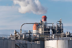Details of an oil refinery with smoking chimneys Royalty Free Stock Images