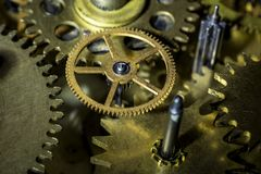 Bronze cog-wheels of old mechanism of clock by close up. royalty free stock photo