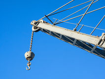 Details of  an old crane: hook, chain, pulley, beam, rivets Stock Image
