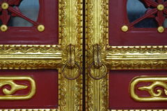 Details of an old door. The door is covered by golden color Royalty Free Stock Photos