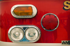 Details of old fire service car, retro. Front of old fire service red car, sixties style, retro Royalty Free Stock Photography