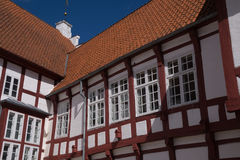 Details of old half timbered building with red tiles and casemate windows Royalty Free Stock Photography