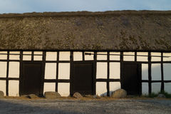 Details of old house. With half timbered walls, wooden doors, and thatched roof Royalty Free Stock Image