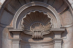 Details of old public drinking fountain carved in stone Stock Image