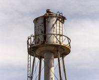 Old, abandoned water tower Stock Images