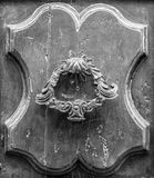 Details of an old wooden door in Florence. stock photography