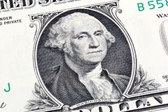Details of a one dollar bill, George Washington in foreground. S. Tacked shot royalty free stock images