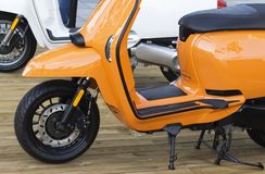 Details of orange moped closeup, outdoors royalty free stock photo