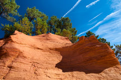 Details of orange rock formation and trees under blue sky on Le Royalty Free Stock Photography