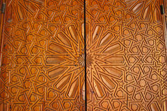 Details of an ornate carved cedar door at the Madrasa Bou Inania Royalty Free Stock Images