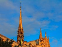 Details of the ornate gothic spire viewed from the southern side of Notre Dame de Paris Cathedral in the warm light of sunset. Details of the ornate gothic spire royalty free stock image