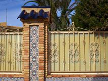 Details of ornate wrought iron elements metal gate Spain. Traditional classic design ornate wrought iron elements metal gate Spain stock photo