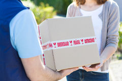 Details of parcel being handed over by a professional Royalty Free Stock Image